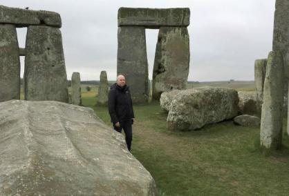 Doctor Rupert Till, music technologist from the University of Huddersfield, poses for a photograph in the stone circle of the ancient monument of Stonehenge, Amesbury, Britain February 22, 2017. Till has co-developed an app that gives users a virtual acoustic tour of Stonehenge as it would have sounded thousands of years ago with all the stones in their original place, complete with soundtrack of Neolithic 'music'. REUTERS/Matthew Stock/Files